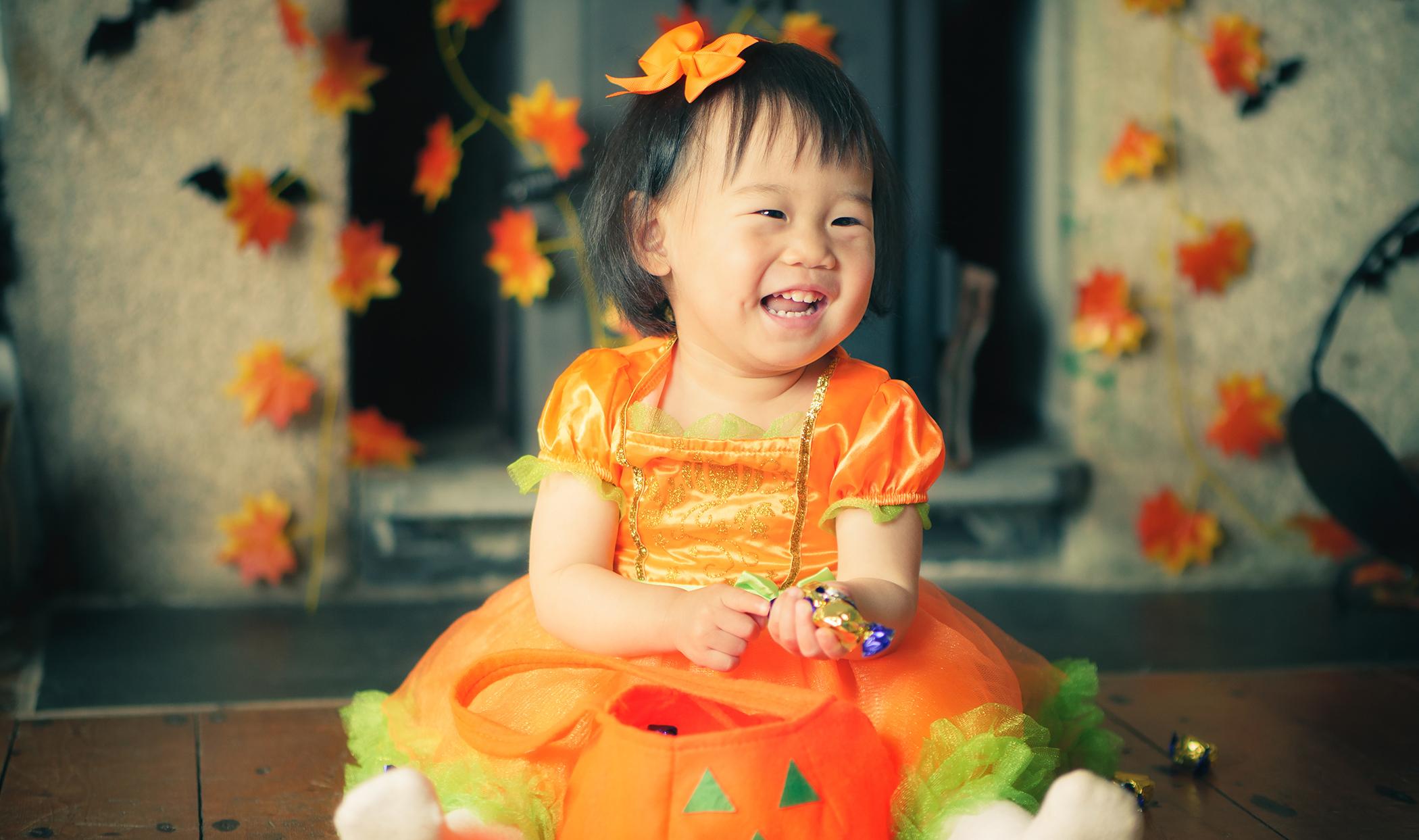 happy baby girl get her halloween candy